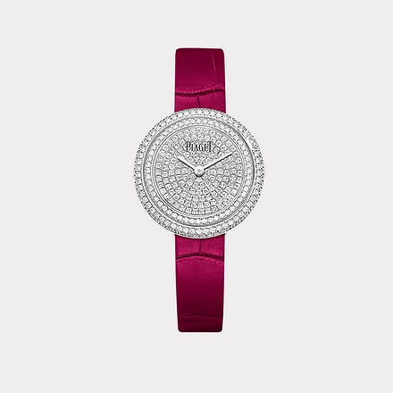 white gold diamond watch with a pink strap