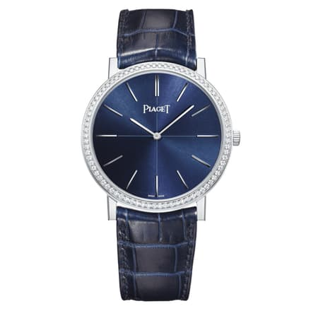 piaget white gold diamond watch with a blue dial