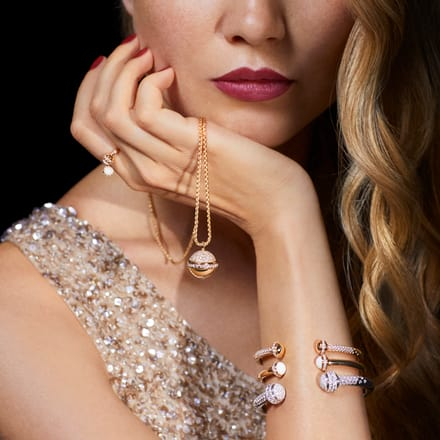 Piaget rose gold pendant and gold diamond bangle bracelets