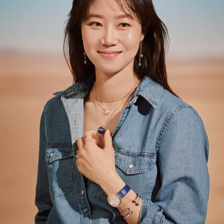 Kong Hyo Jin matching a rose gold watch with diamond bangle bracelets