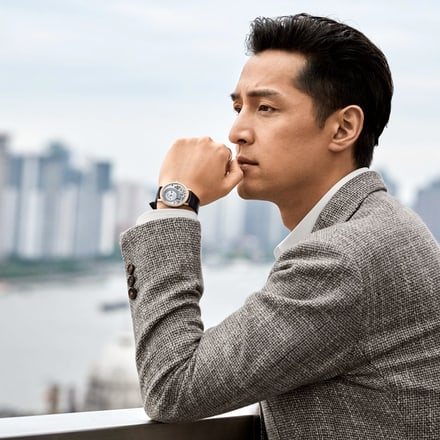 Hu Ge with a Piaget Altiplano ultra-thin watch