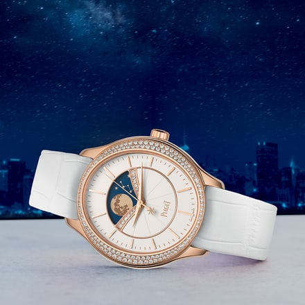 woman gold and diamond moonphase watch