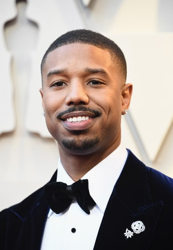 Michael B Jordan wears Piaget diamond brooches at the 2019 Oscars