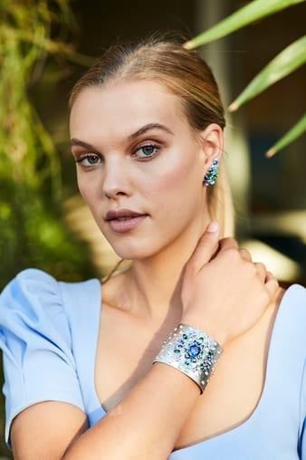 Model wearing Piaget diamond earrings