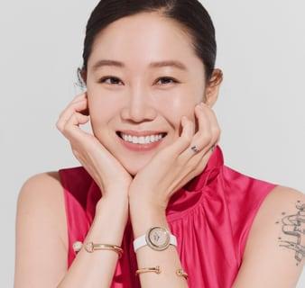 Kong Hyo Jin wearing a yellow gold diamond watch with diamond bangle bracelets