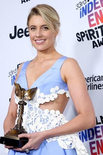 Greta Gerwig wears Piaget high jewelry earrings at the Spirit Awards