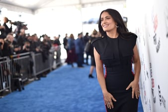 Salma Hayek wears Piaget high jewelry earrings and ring at the Spirit Awards