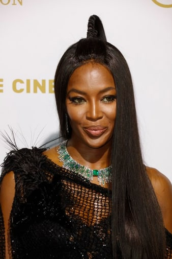Naomi Campbell wearing Piaget jewels at Cannes film festival